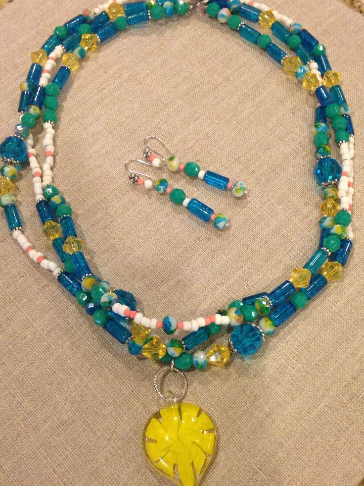 A personal favorite from my Etsy shop https://www.etsy.com/listing/236161624/colorful-beaded-necklace-glass-pendant