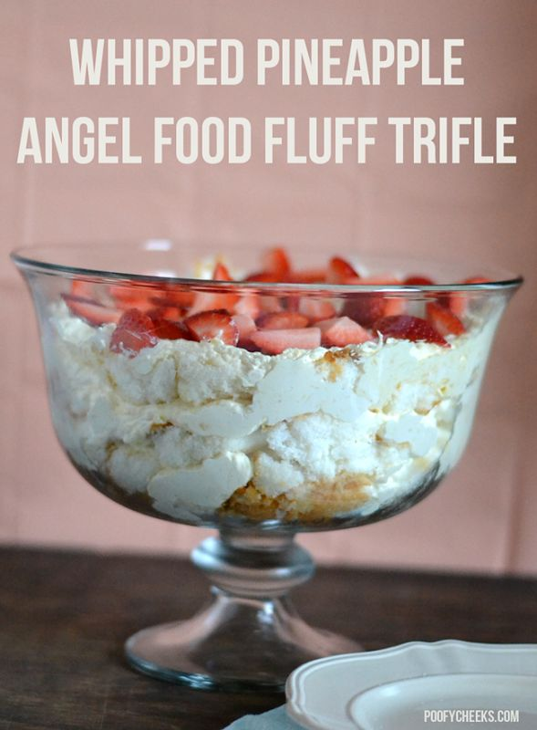 Whipped pineapple angel food fluff trifle is the perfect dessert for a crowd. Layers of angel food, strawberries and a whipped pineapple filling.