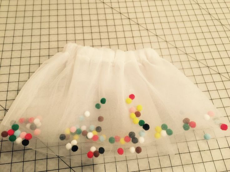 If you're like me, and saw this amazing pom pom tutu image floating around Pinterest and clicked on it only to find it took you to a page with instructions in Dutch (or whatever), you and I were both SUPER disappointed!!!    Of course, I had to figure out how to