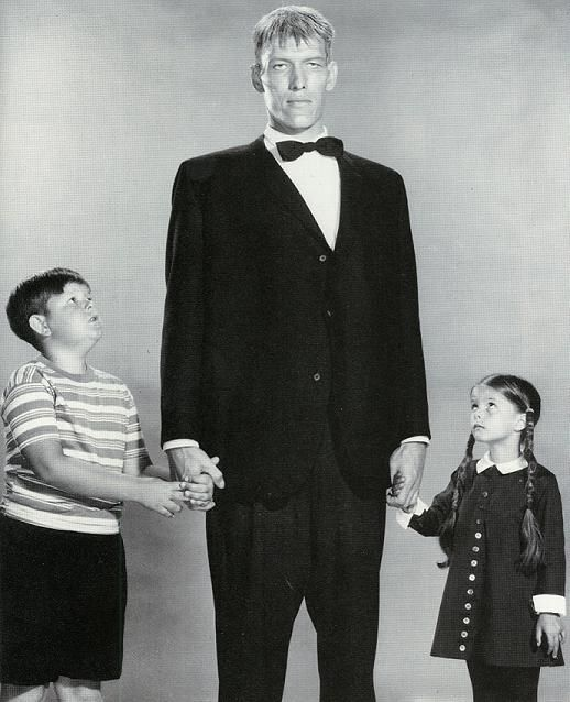 "Ted Cassidy minding the children as Lurch on ""The Addams Family."""