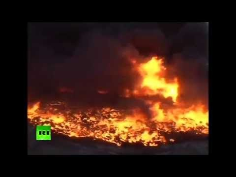 Iraq oil field set on fire by ISIS almost a month ago is still burning - YouTube