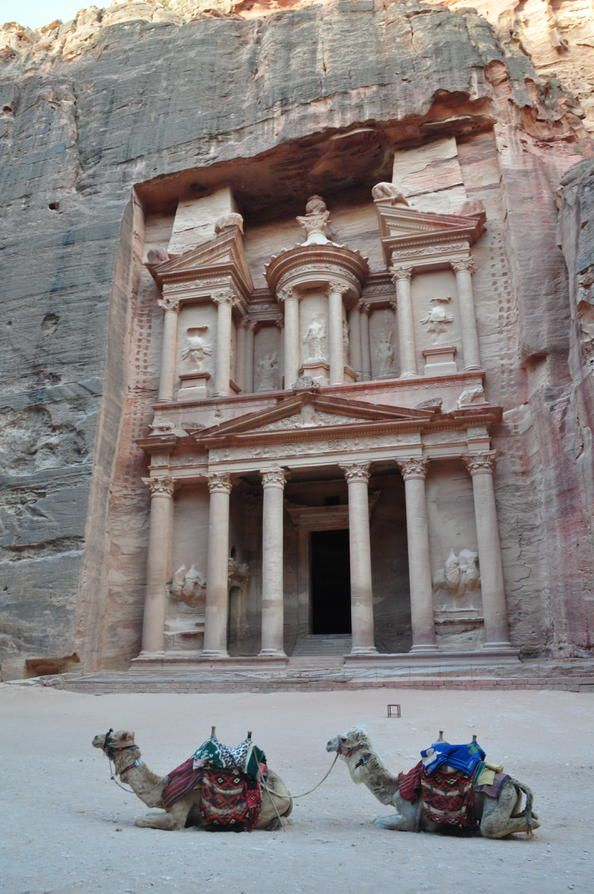 Petra - the fabled Rose-Red Nabatean city located in Jordan. It is recognised by UNESCO as a World Heritage Site and was once the capital of the Nabatean kingdom during the 6th centtury.  The buildings are carved out of the living rock and can be said to glow during certain times of the day.