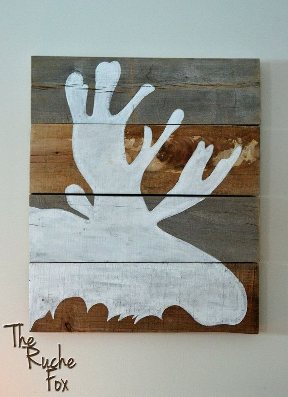Moose Silhouette Painting on Reclaimed Wood by TheRucheFox on Etsy, $50.00.  I think I could make this myself, with help from the boy.