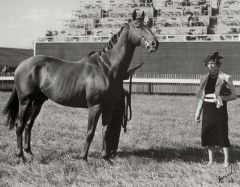 Marion du Pont Scott with Battleship, a son of Man o' War who became the first American-bred horse to win the Grand National at Aintree