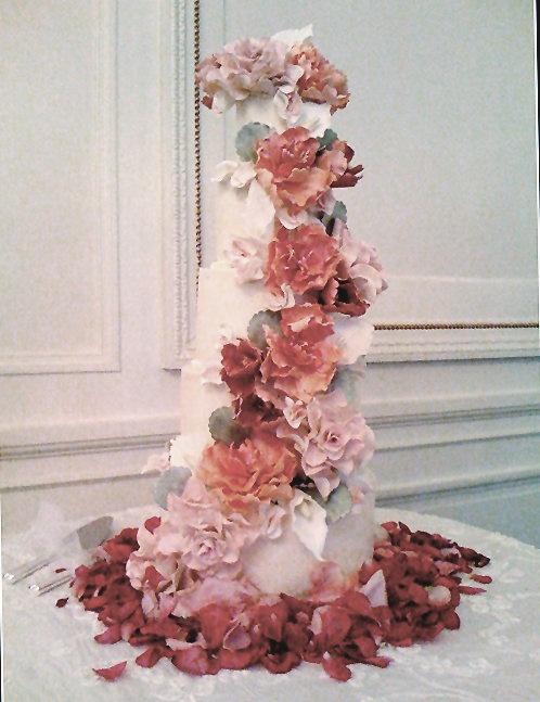We love this 5 tier orange,pink, burgundy colored wedding cake