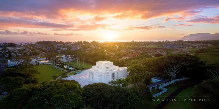 Laie Temple Ocean Glow - A lovely glow comes from the setting sun over the ocean near the Laie Hawaii Temple. Part of Alan Fullmer's From On High series at LDS Temple Pictures.
