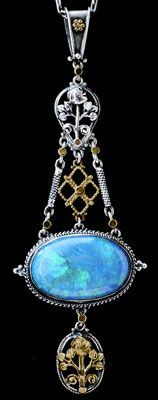 """ARTIFICERS' GUILD 1901-1942 Arts & Crafts Pendant designed by Edward Spencer. Silver Gold Opal. H: 8 cm (3.15 in)  W: 2.6 cm (1.02 in) British, c.1905."