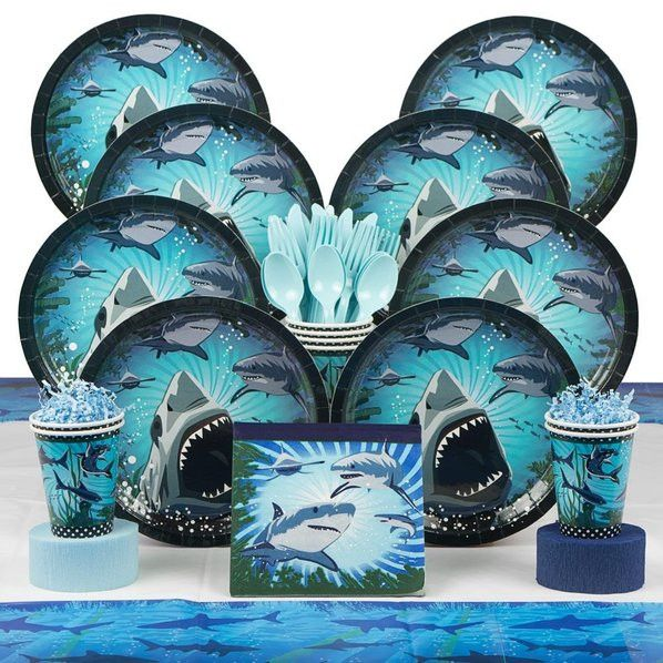 The Shark Party Deluxe Kit. It will serve up to eight individuals, and includes: - 8 Shark Cake Plates - 8 Shark 9oz Cups - 16 Shark Luncheon Napkins - 8 Forks, 8 Spoons, 8 Knives - 2 Sets of Streamer