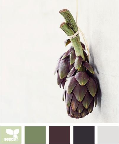 artichoke tones    kitchen--w/ stainless steel appliances    light green walls  dark gray/purple cupboards  stainless steel hardware  granite counter tops (gray, purple, green speckles)