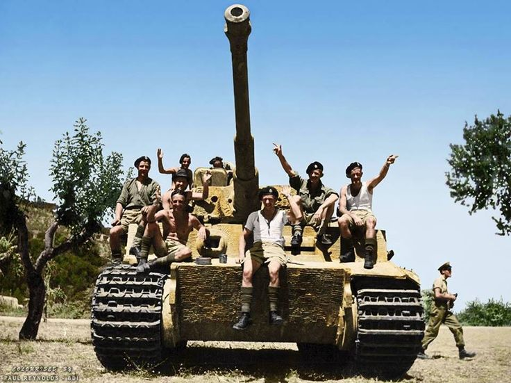 Members of the 22nd New Zealand Motor Battalion, on a captured German Panzer VI 'Tiger' tank of the sPz.Abt.508, in the village of La Romola, Italy, on the 2nd of August 1944.  (Source - The National Library of New Zealand - Photograph by NZ official photographer - George Kaye)  (Colourised by Paul Reynolds.