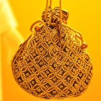 Beadwork potli bags exclusive from Bhopal    Bhopal is the capital city of Madhya Pradesh (MP). Bhopal is known for the most famous and unique beadwork. This beadwork is available on Potli Bags, Purses, Wallets, Cushion Covers etc