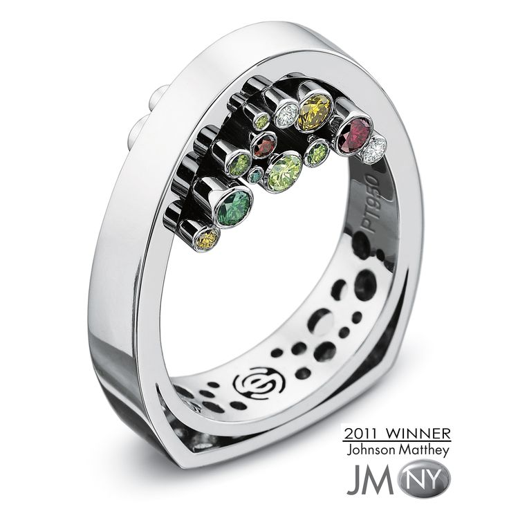 This unique setting of colored diamonds was inspired by and named in honor of Hans Hollein, the contemporary architect of the famous Juwelier Schullin store in Vienna, Austria. In the Hollein ring,...