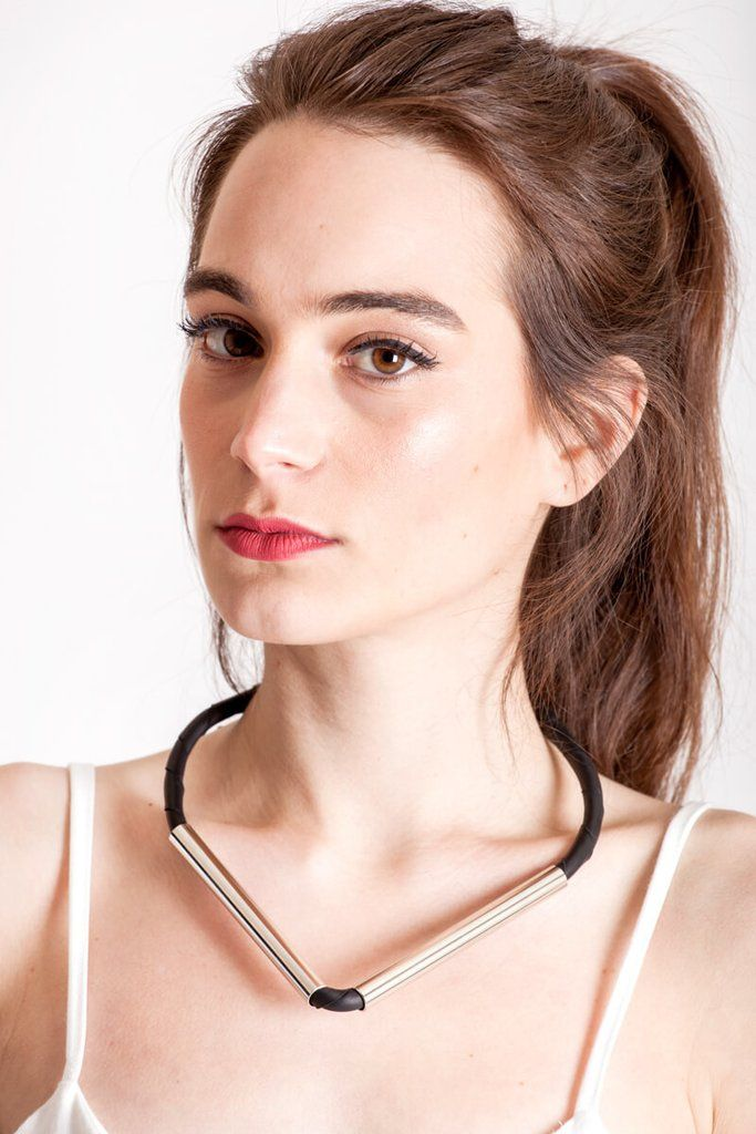 Triangle necklace made of the finest leather, hand-cut, hand polished and galvanized brass. Silver edition.