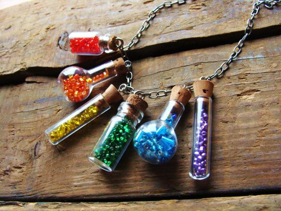 Little rainbow bottle necklace - fill bottles with gems, beads, crystal, sand, flowers or whatever. Bottles available from rings-things.com.