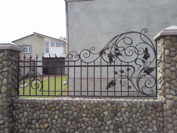 Rubble stone, smooth lines of the wrought iron fence and beautiful details will make the original fence.
