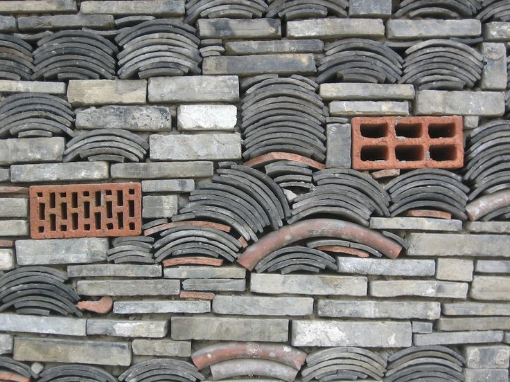 """Architect Wang Shu's Ningbo History Museum in Ningbo, China incorporates """"Wa Pan"""" into its exterior; a traditional building technique that u..."""