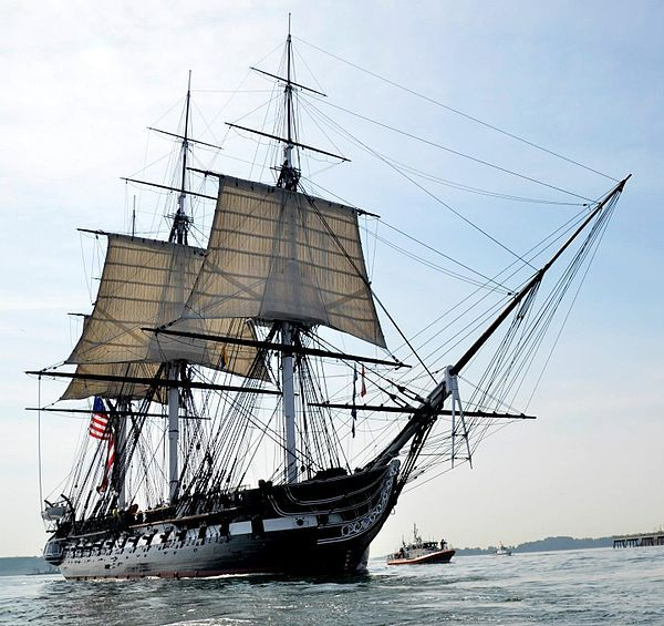 """USS Constitution, nicknamed """"Old Ironsides"""" resides in Charlestown Harbor, Massachusetts. It is a wooden-hulled, three-masted heavy frigate of the U. S. Navy. Named by President George Washington after the Constitution of the United States, she is the oldest commissioned naval vessel afloat."""