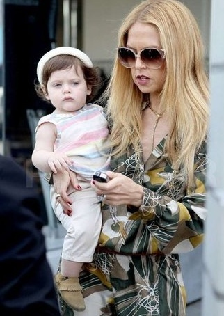 Suris Burn Book....    This is a very judgmental look coming from a baby wearing pastel stripes, mocassins, and a lock of hair so perfectly placed, it could have only been done with a curling iron and most of the hairspray in Los Angeles County.    Rachel Zoe, your baby looks like one of those porcelain dolls that creepy people order from catalogs.: Baby Wearing, Porcelain Dolls, Angel County, Creepy People, Los Angeles, Burning Books, People Order, Curls Irons, Pastel Stripes