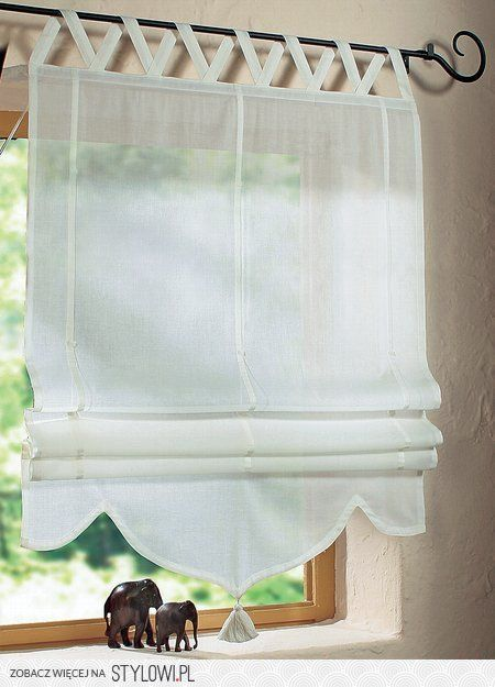 Date: 09-10-2016 Note: A very neutral color and simple curtain, with a tassel trimming at the end. perfect to use it in a small window and small space.