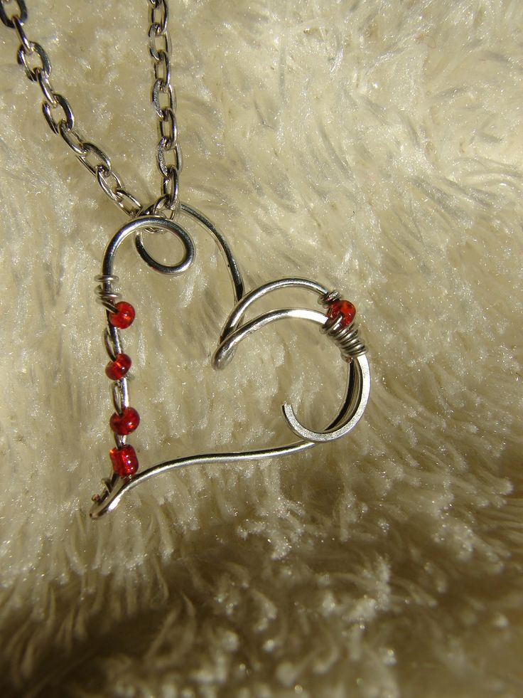 Heart pendant. (For more happy healthy humorous & creative hoopspiration please check out: www.HipTheHoopla.com & www.facebook.com/HipTheHoopla thanks! :) Also www.ToucheToon.com (cartoon humor) & www.DatingAndHandGrenades.com (relationship humor :-)