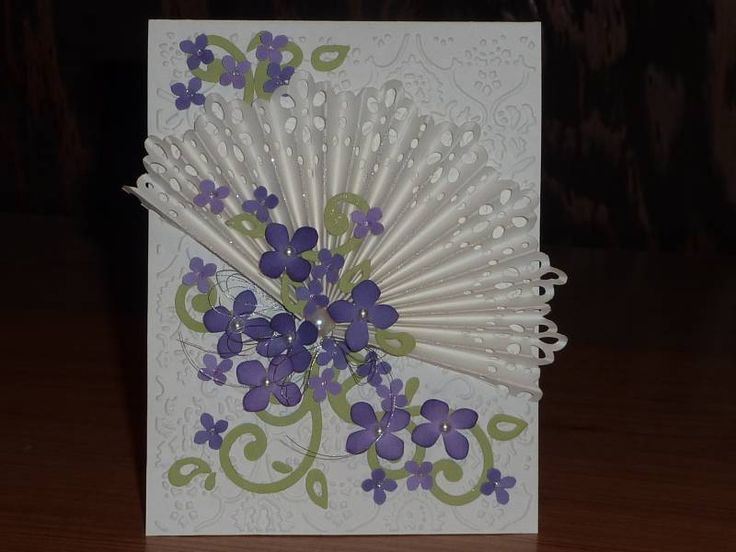 Martha Stewart punch for the fan and the hydrangea punch for the flowers. The swirls are from sizzix; background folder is from cuttlebug.   Keywords: F4A107 IC327 Martha Stewart cuttlebug fans hydrangea    Stamps: none    Paper: white, lavendar lace, lovely lilac, celery    Ink: concord distress    Accessories: sparkly threads, pearls, glitter, sizzix die, cuttlebug folder