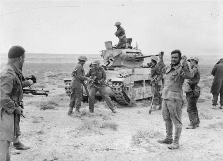 New Zealander soldiers recapture a Matilda tank, previously captured by the Germans, and take prisoner its German crew. December 1941.