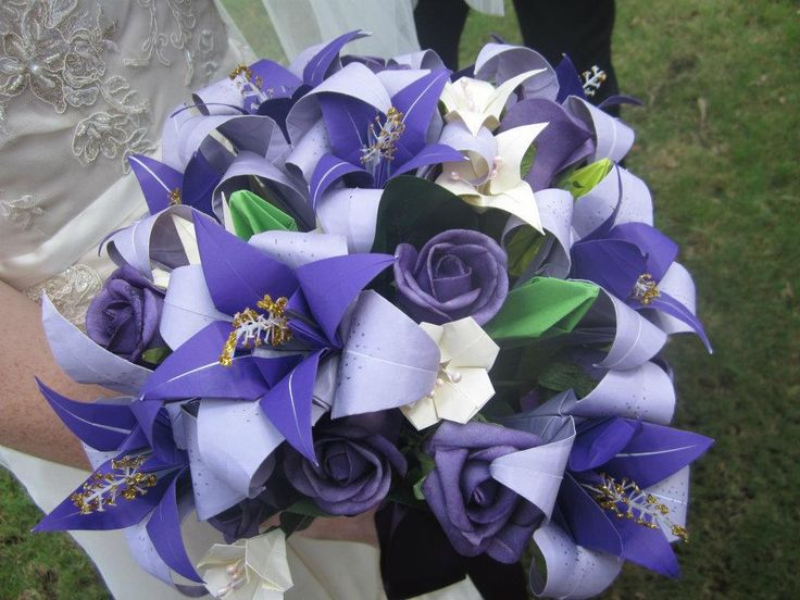 I would make my bouquet a combination of blues, purples and pinks and add in *white* silk flowers here and there
