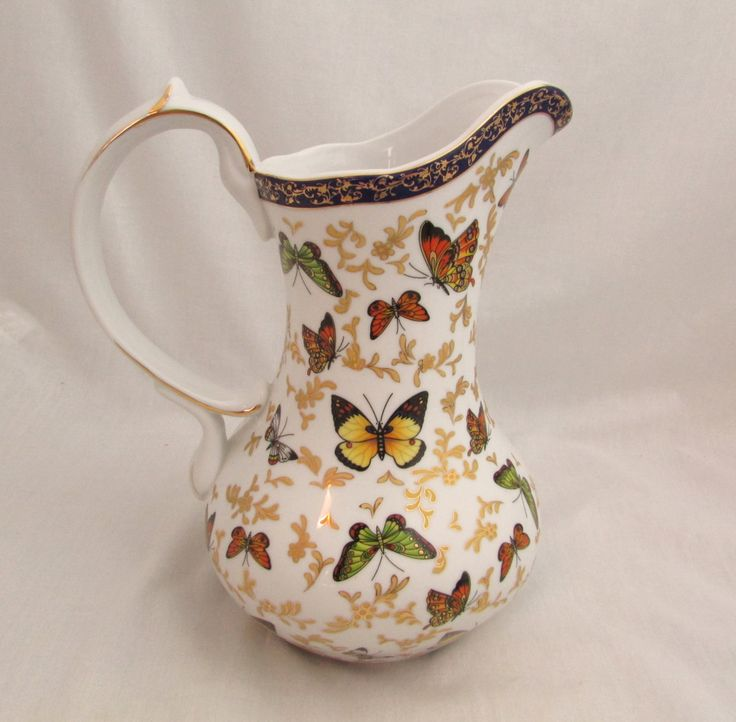 Vintage Formalities Water Pitcher by Baum Bros - Butterfly Collection by GrannyBeansBoutique on Etsy https://www.etsy.com/listing/493284285/vintage-formalities-water-pitcher-by