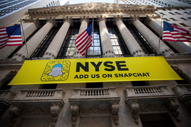A Snapchat sign is displayed outside of the New York Stock Exchange in November of...