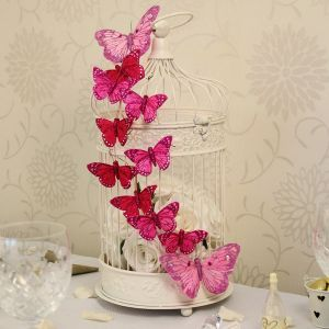 Combine a cream bird cage with butterflies of your colour theme to get a stunning effect