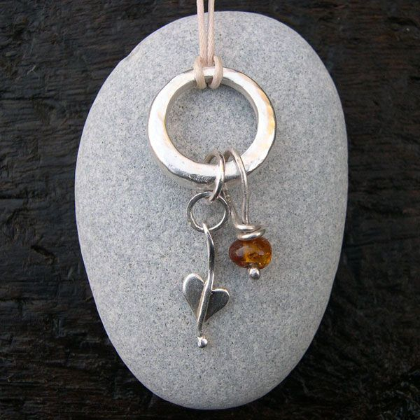 Amber and silver necklace http://www.silverandstone.co.uk/html/gold_silver_necklaces_pendants.html