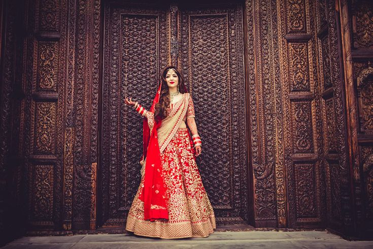 A traditional Red & Gold Sabyasachi lehenga for Bride Henna. Photos Courtesy: Hitched and Clicked