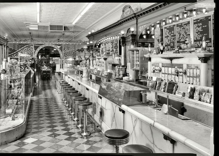 "April 1974. Columbus, Indiana. ""General view of soda fountain area -- Zaharako Bros. Ice Cream Parlor, 329 Washington Street. Family-run ice cream and confectionery business operating since 1900 Shorpy Historical Photo Archive :: Fountain Service: 1974"