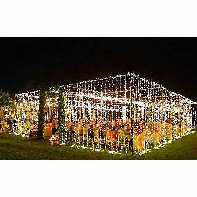 Twinkle light walls under an open sky. from the Bali Bride