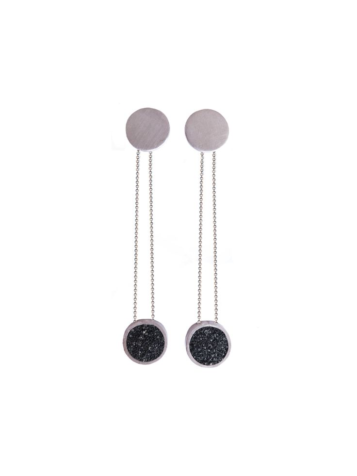 earings made of silver and sand