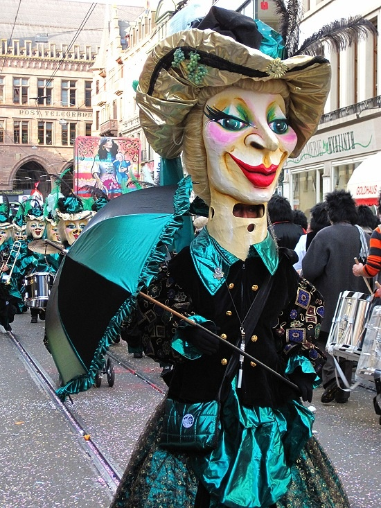 Fasnacht (winter carnival) in Basel. Fasnacht is celebrated all over Switzerland, but Basel is the biggest. It lasts three days, even running through the night. Basel | Switzerland