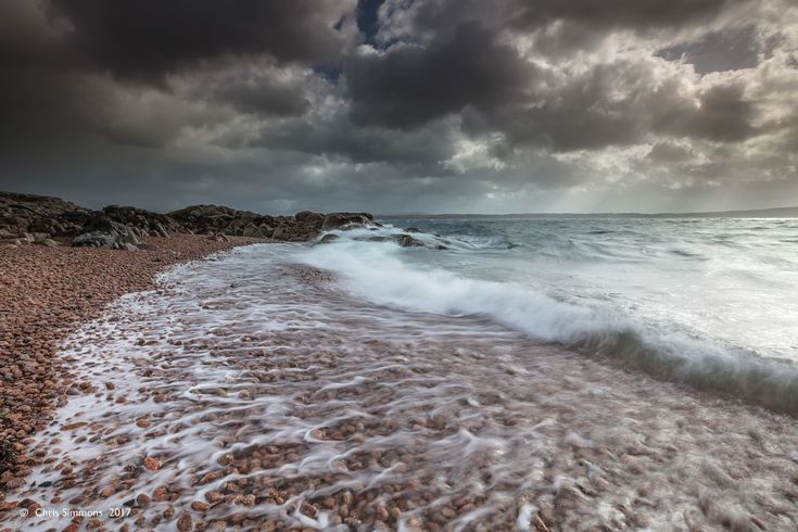 Tideline Under Brightening Skies by Chris Simmons Photography