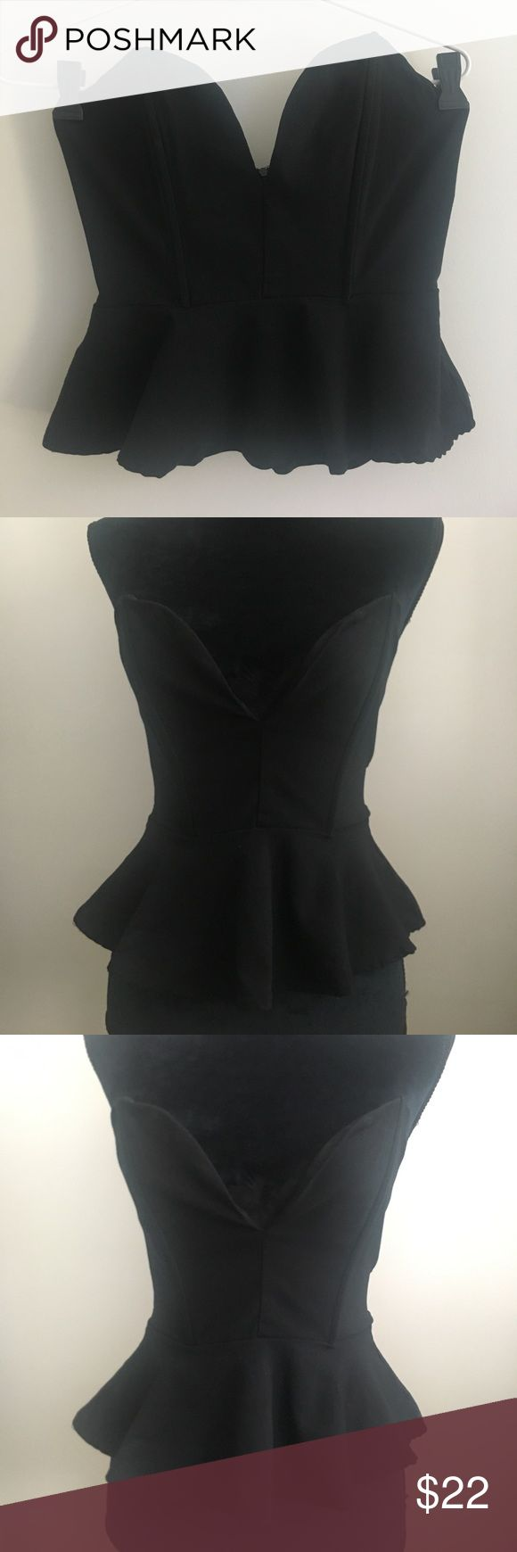 Black low v slit tube top Black tube top with low v neck slit. Zipper closure in back. Slightly cropped has peplum ruffle at bottom. Great condition. b sharp Tops Crop Tops