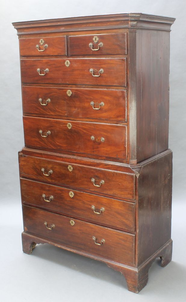 """Lot 997, A George III mahogany chest on chest, the upper section with moulded cornice and fluted canted corners, fitted 2 short and 3 long drawers, the base fitted 3 long drawers 73""""h x 44""""w x 22""""d est £200-400"""