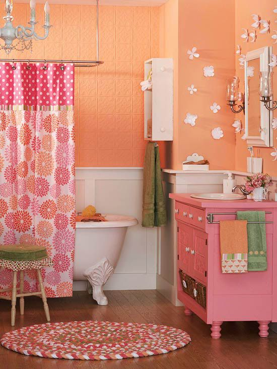 Inspired by a zinnia-pattern shower curtain, bright sherbet colors give this eclectic bath an engaging personality.