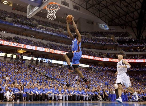 Oklahoma City's James Harden (13) goes past Dallas' Jason Kidd (2) for a dunk during Game 3 of the first round in the NBA playoffs between the Oklahoma City Thunder and the Dallas Mavericks at American Airlines Center in Dallas, Thursday, May 3, 2012. Photo by Bryan Terry, The Oklahoman