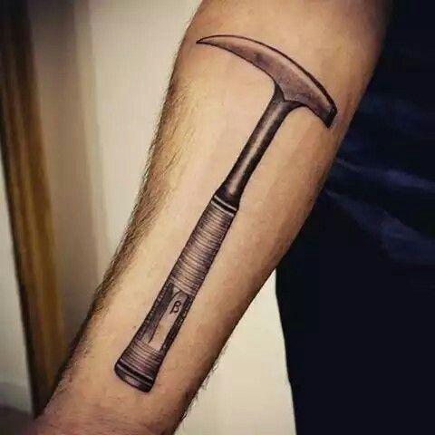 Geological hammer tattoo - love the dedication