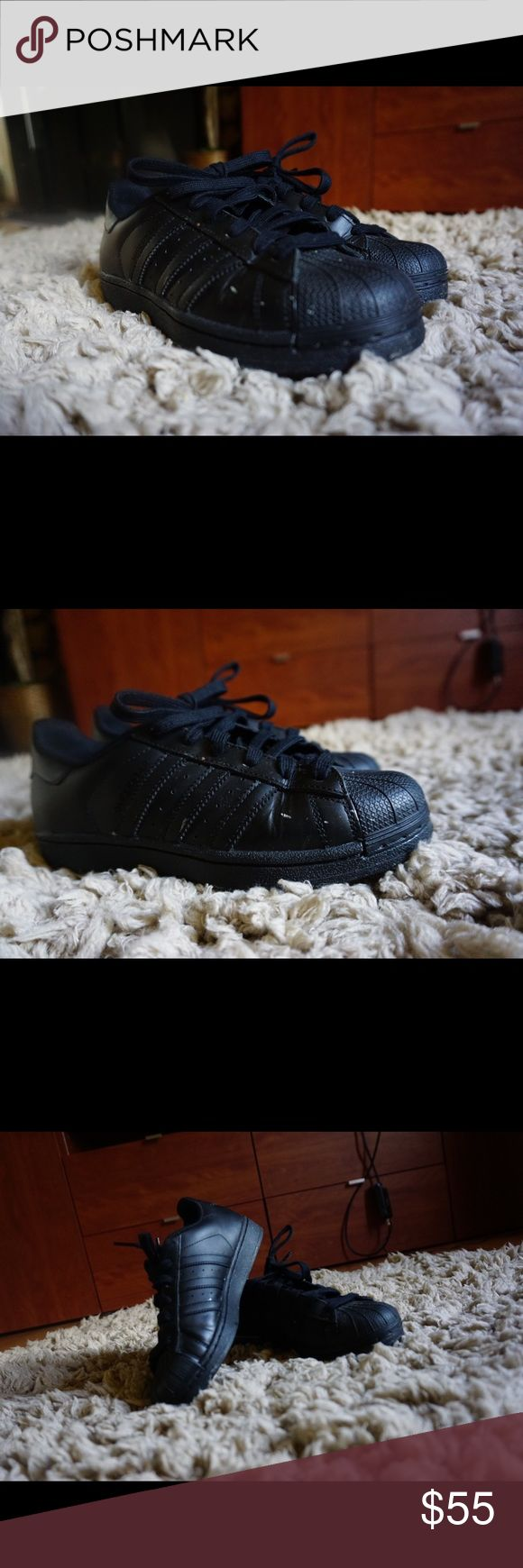 Black superstar Adidas I'm selling two of these. One is a men's US size 4. The other is a men's US size 3.5. The size 4 is a women's 6.5 true fit. And the other is a women's size 6 true fit. I know this because I'm usually a size 6 and the 3.5 one fits snugly with socks on. adidas Shoes Sneakers