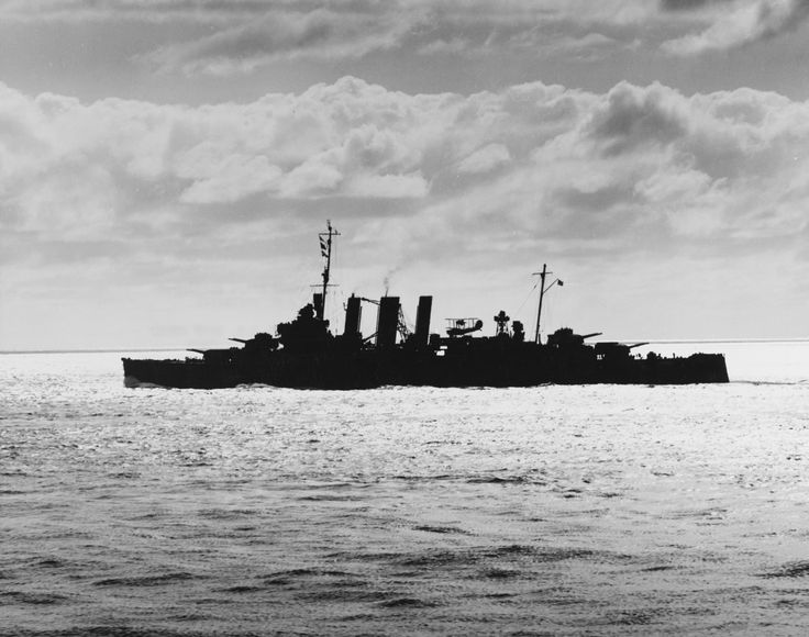 HMAS Australia silhouetted against the sun while at sea in the south Pacific, 4 August 1943 [3600 x 2841]