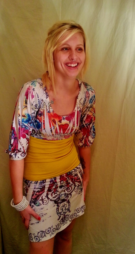 Note: Top cut in half, coordinating fabric joining bodice ...