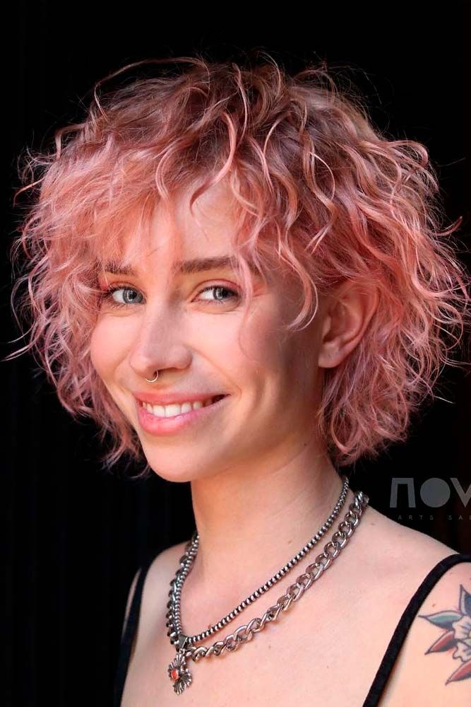 The Pink Hair Trend The Latest Ideas To Copy The Best Products To Try Pink Curls Short Wavy Hair Curly Hair Styles
