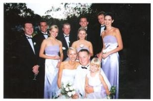 Bridesmaids with their Empire semi A-line dress in Lilac with Bride in Beautiful Semi A-line wedding gown