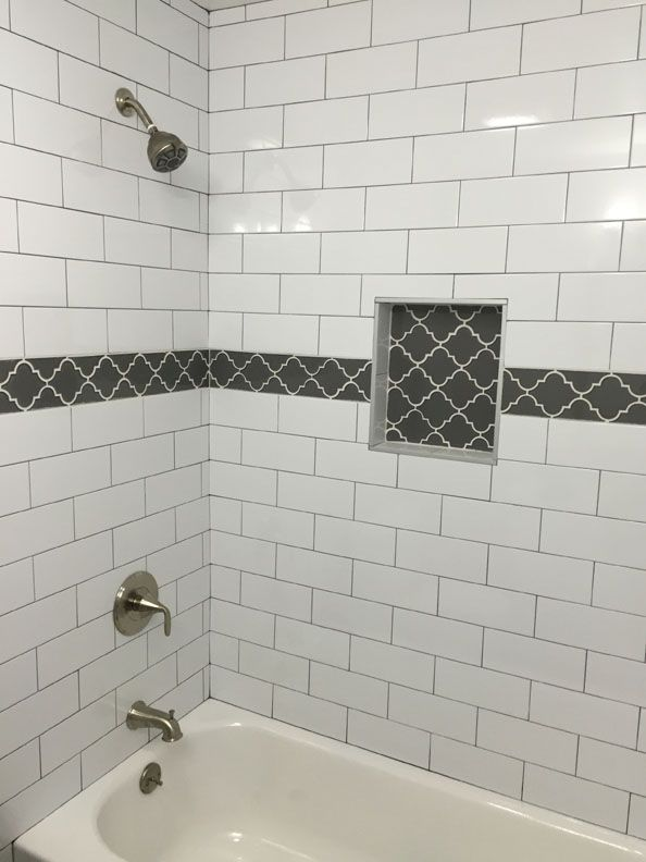 White subway tile grey grout bathroom