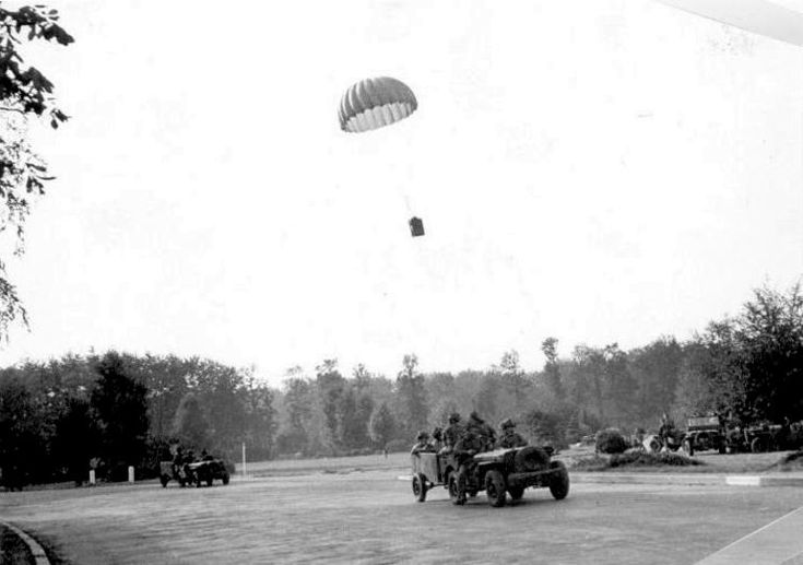 British paratroopers in the Oosterbeek Perimeter A lone wicker basket with long awaited supplies lands in the lawn in front of the Hartenstein Hotel on Utrechtse Weg in Oosterbeek. The Hartenstein was the British 1st Airborne Divisional HQ during the Battle of Arnhem.