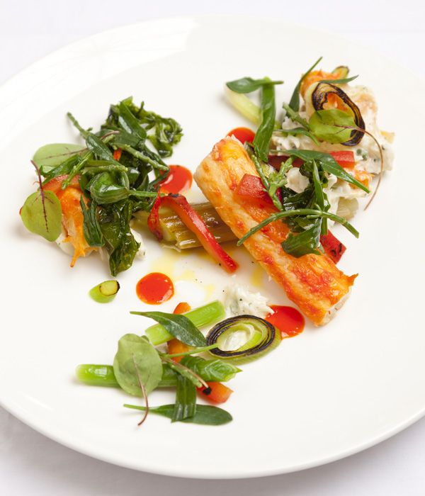This king crab and leek recipe from Dave Watts produces a feast for the senses - meaty Alaska king crab is paired with burnt leek and sea vegetables, with a dressing of red pepper and cardamom.